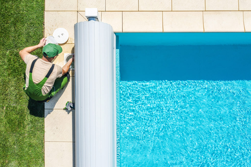 Outdoor Swimming Pool Skimmer Filter Cleaning Aerial View